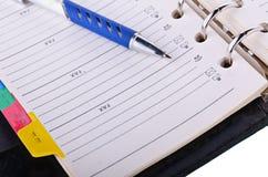 Open notitieboekje en pen royalty-vrije stock foto