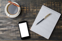 Open notitieboekje met kop van koffie Stock Foto