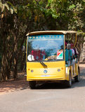 Open observation bus with tourists at Angkor Royalty Free Stock Photo