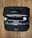Open Office Travel Bag on Floor Royalty Free Stock Images