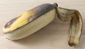 Open Old Banana Fruit on Wooden Table Stock Images