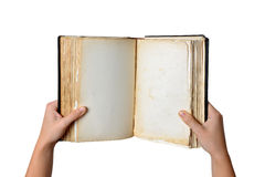 Open old blank book in hands Stock Photos