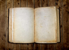 Open old blank book. On wooden table Stock Image
