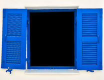 Open old blue window on the white wall Stock Photos