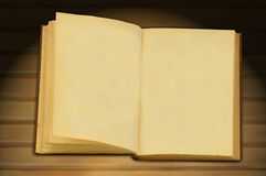 Open old book. An old book opened to blank pages with wood background stock images