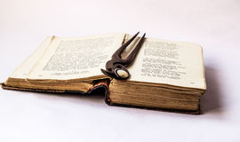 Open old book. Book   in the old cover and wooden clip with pearl Royalty Free Stock Photography