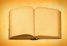 Open old book against retro background Royalty Free Stock Photo