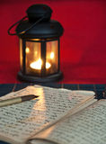 An open old book by the candlelight Stock Image