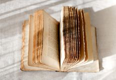 Open old book with faded pages stock images
