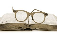Open old book and glasses Royalty Free Stock Photo