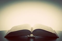 Open old book, light from above. Imagination, education royalty free stock photography