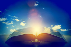 Open Old Book, Light From The Sky, Heaven. Education, Religion Concept Stock Photography