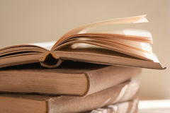 Open old book. Pile of old books with an open book on top Royalty Free Stock Images