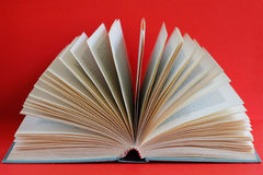 Open old book red background Royalty Free Stock Photo