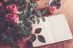 Open old book and roses Royalty Free Stock Photos