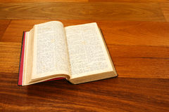 Open old book on wood table Royalty Free Stock Image