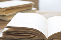 Open old book on wooden table Stock Photography
