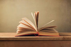 Open old book on wooden table Royalty Free Stock Photography
