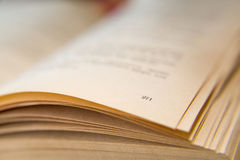 Open old book. Yellowed pages. Page number 271. Paper texture. Macro.  Royalty Free Stock Images