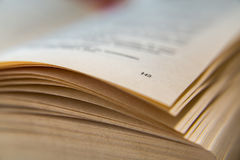 Open old book. Yellowed pages. Page number 143. Paper texture. Macro.  Royalty Free Stock Image