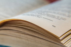 Open old book. Yellowed pages. Page number 143. Paper texture. Macro Royalty Free Stock Images