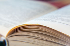 Open old book. Yellowed pages. Paper texture. Macro.  Stock Photography