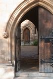 Open old doorway. Heavy ornamented doorway leading to a gloomy patio Royalty Free Stock Photo