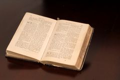 An open old German bible resting on a table Royalty Free Stock Photos