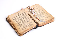 Open old holy. Bible with cross Stock Photo