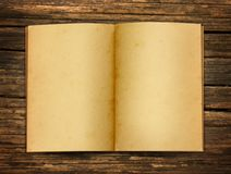 Open old paper. And book on old wood background Stock Image