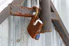 Open old rusty padlocks hang on the gate Stock Image