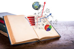 Open old vintage book with business graph. On wooden table  (Elements of this image furnished by NASA Stock Image