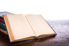 Open old vintage book. On wooden background Stock Images
