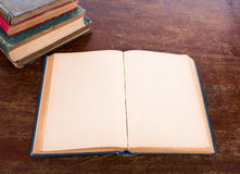 Open old vintage book. On wooden table Royalty Free Stock Photography
