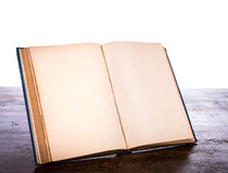 Open old vintage book. On wooden table Royalty Free Stock Photo