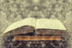 Open old vintage books on wooden background with fantastic double exposure effect Royalty Free Stock Photography