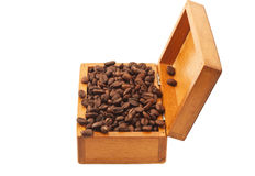 Open old wooden box with coffee beans isolated Stock Images