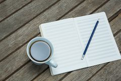 An open organiser with mug of coffee Royalty Free Stock Photo