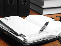 Open organizer and documents. Still life. Royalty Free Stock Photography