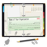 Open organizer with pencil and bank check Royalty Free Stock Photos