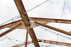 Open overhead girders and trusses covered in rust Royalty Free Stock Photo