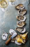 Open Oysters with lemon and wine Royalty Free Stock Image