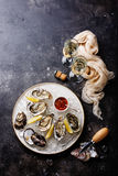 Open Oysters with spicy sauce and champagne Royalty Free Stock Photo
