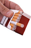 Open pack of cigarettes Stock Images
