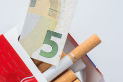 Open pack of cigarettes, five euro Stock Photo