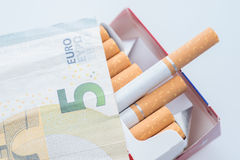 Open pack of cigarettes, five euro Royalty Free Stock Photo
