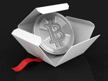 Open package with Bitcoin Royalty Free Stock Image