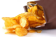 Open packet of crisps. On white royalty free stock image