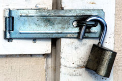 Open padlock on dirty shed door Royalty Free Stock Images
