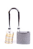 Open a padlock and a stack of coins Royalty Free Stock Photo